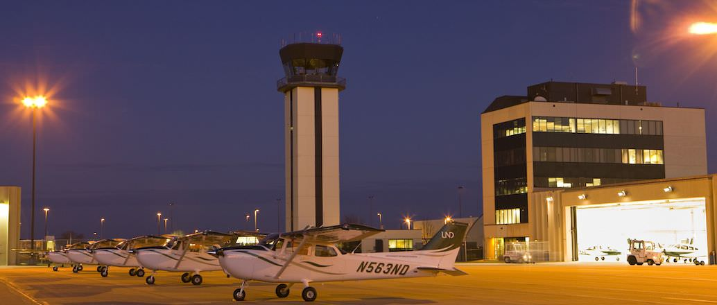 UND planes at the GF airport at night