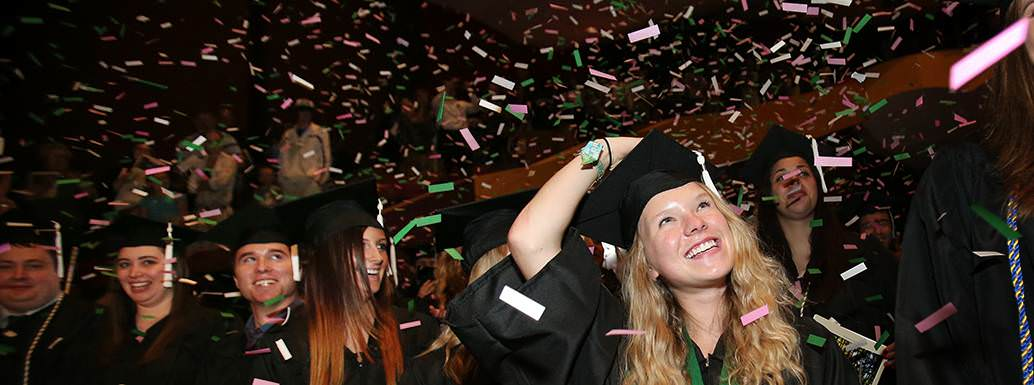 Students celebrating graduation from UND.