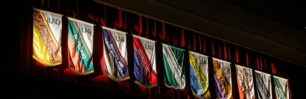 UND College Flags displayed at Commencement