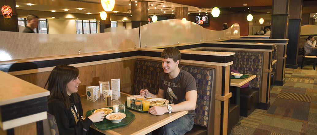Students eating at a booth in Squires Dining Center