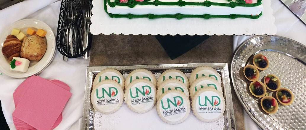 Cookies decorated with the UND logo created by Campus Catering