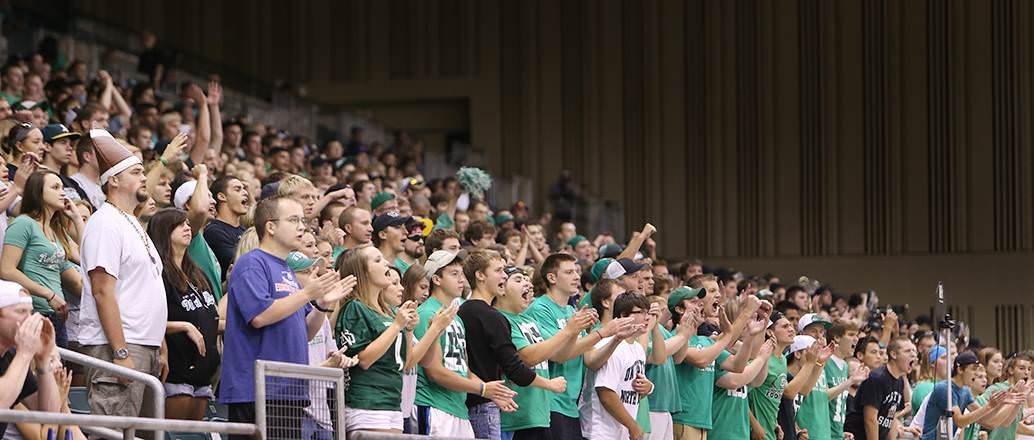 Students cheering at UND football game