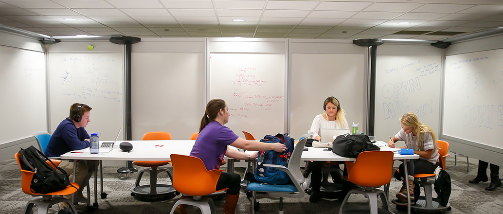 Students studying in Union basement lounge