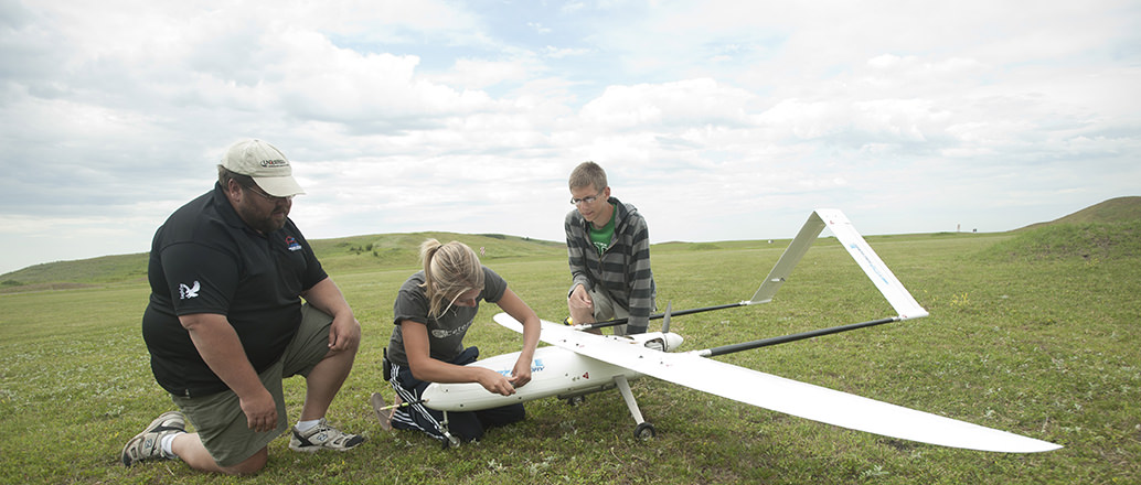 Mechanical engineering students working on a UAS