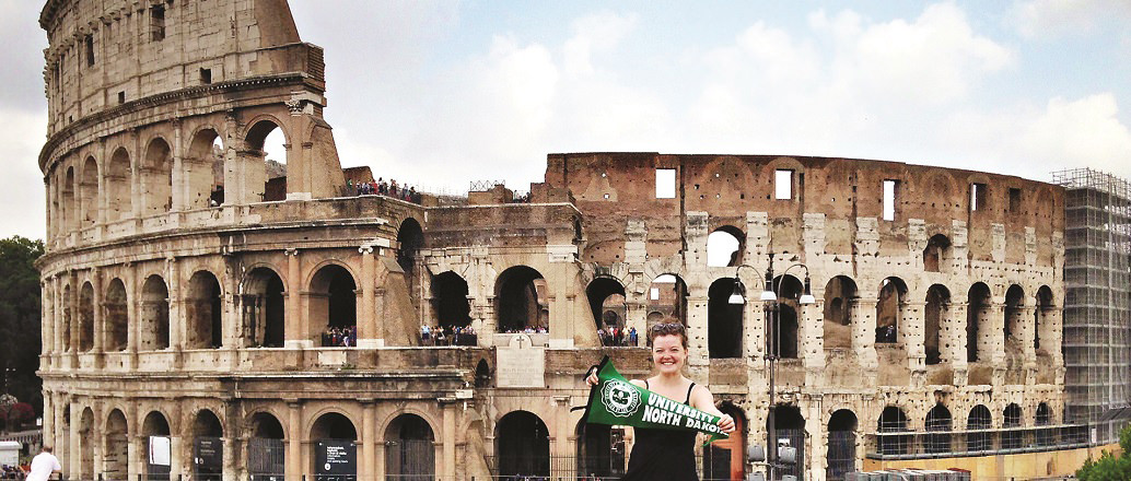 UND student in front of Roman Colosseum