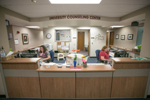 Amberkay Crotts (left) student employee, and Lisa Moore, administrative assistant, serve to welcome students and others in the UND community to the Counseling Center