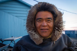 Night Watchman in Arviat; Photograph was taken at 3 a.m. in full daylight.