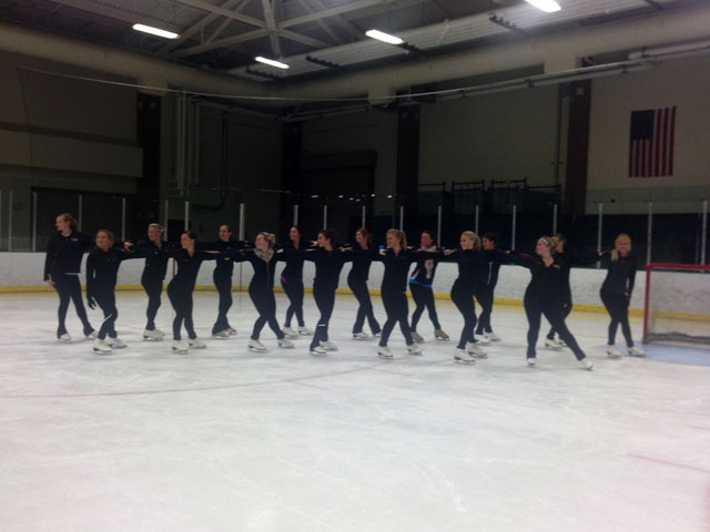 The UND Hockey Cheer Team works together to improve their skating skills.