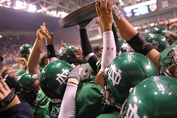 UND raises the Nickel Trophy in the Alerus Center.